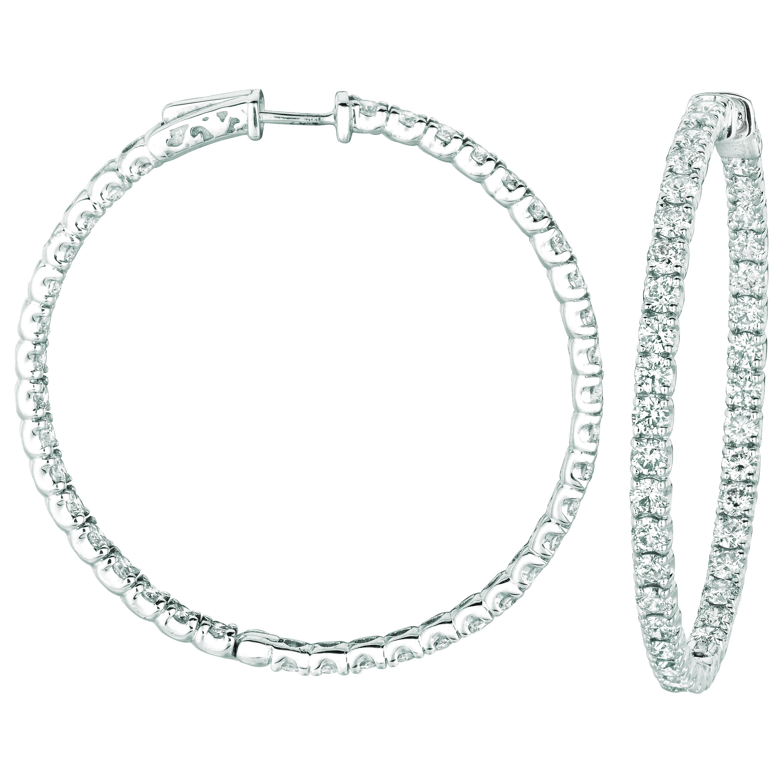 10 Pointer hoop earrings/patented snap lock. Price: $13745.33