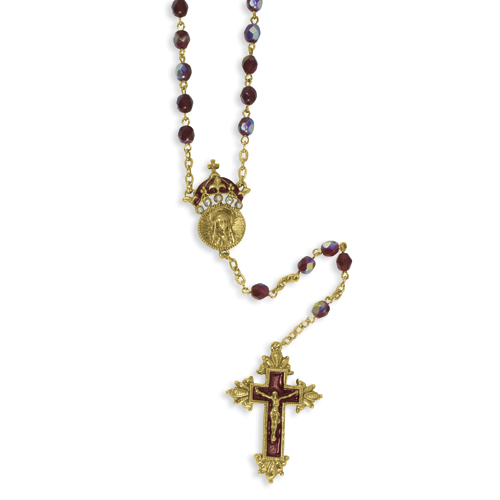 Gold-tone King of Kings Crucifix 28in Rosary. Price: $50.00